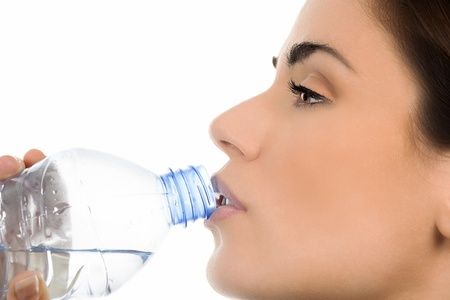 Young woman drinking mineral water bottle,  photo