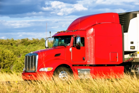 Red truck moving on a highway  photo