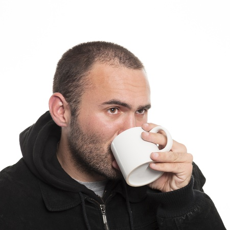 lonely man drinking tea on white background photo