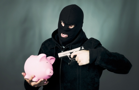 man with a gun and piggy bank, special photographic processing photo