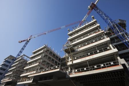 big construction site with cranes and blue sky photo