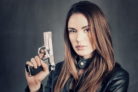 beautiful woman holding up her gun