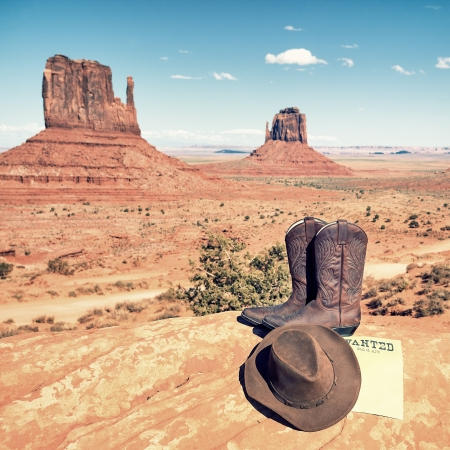 boots and hat at Monument Valley, USA photo