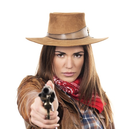 beauty saloon: beautiful cowgirl with gun on white background