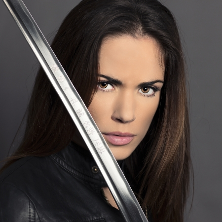 Portrait of girl with Katana in studio photo