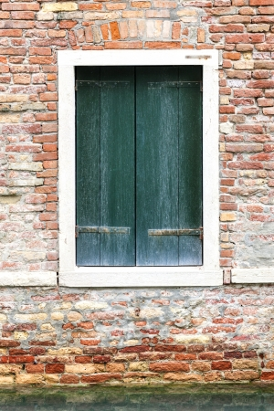 Windows of old house in Venice, Italy photo
