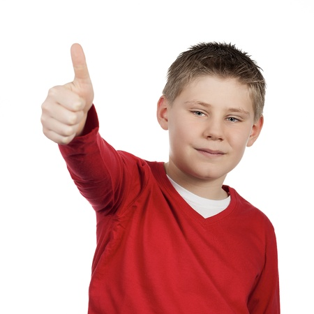 boy giving you thumb up isolated on white background  photo