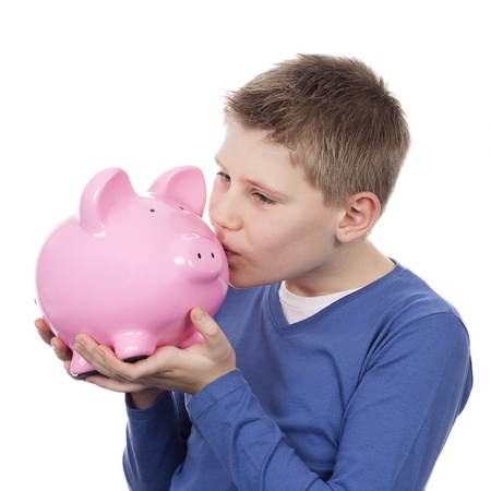 cute boy kissing pink piggybank on white background photo