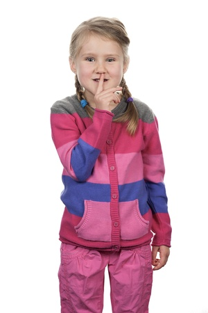 noiseless: Portrait of cute girl with silence gesture over white background