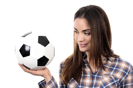 Beautiful woman with ball over white background  photo