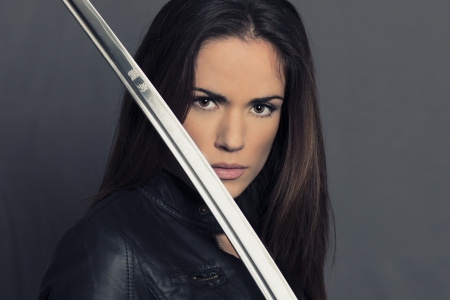 Portrait of beautiful girl with Katana in studio photo