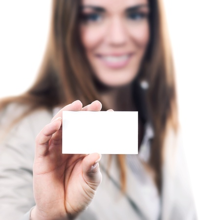 woman handing a blank business card over white background  photo