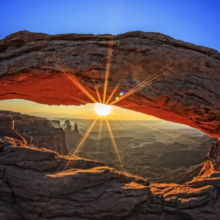 arches national park: famous sunrise at Mesa Arch in Canyonlands National Park, Utah, USA