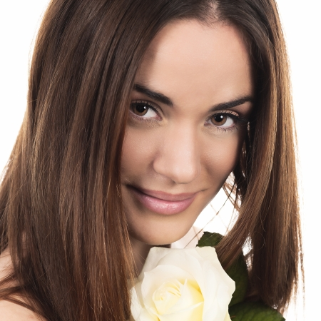 Portrait of beautiful woman with white rose in studio photo