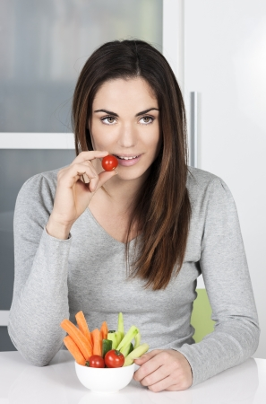 Cute girl eating healthy food at home photo