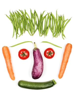 Happy vegetables face on white background photo
