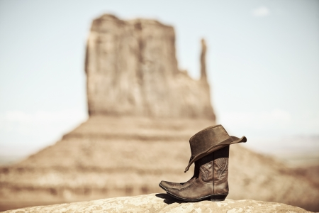 drawingpin: view of boots and hat in Monument Valley, USA