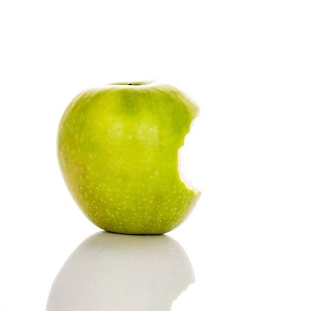 image of bitten green apple on a white background Reklamní fotografie