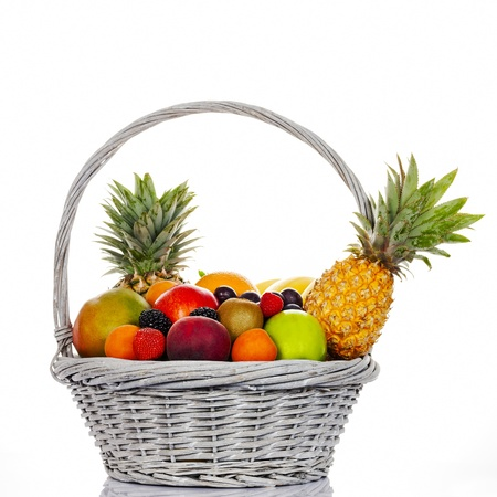 Composition with assorted fruits in wicker basket on white background photo