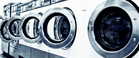 laundromat: industrial washing machines in a public laundromat  Stock Photo