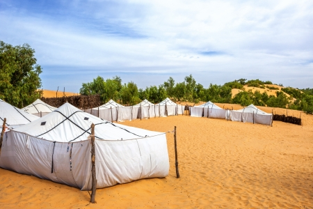 touristic tents on a sand at the evening  photo