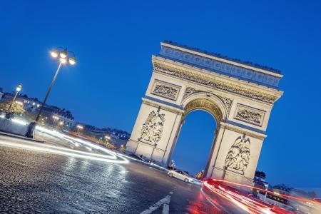 triumphe: Arc de Triomphe, Paris, France at night. Stock Photo