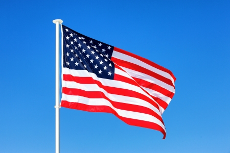 American flag waving in blue sky photo
