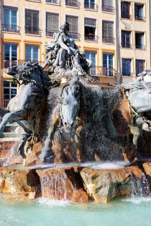chariot: The Bartholdi Fountain at the Place des Terreaux in Lyon, France
