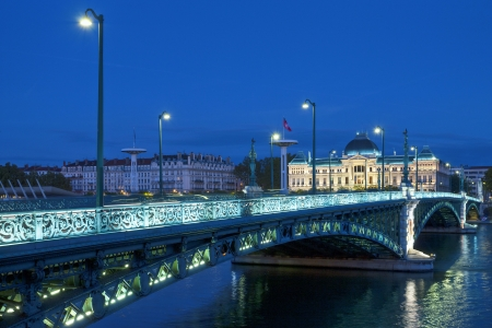 rhone: View of famous bridge and University in Lyon by night