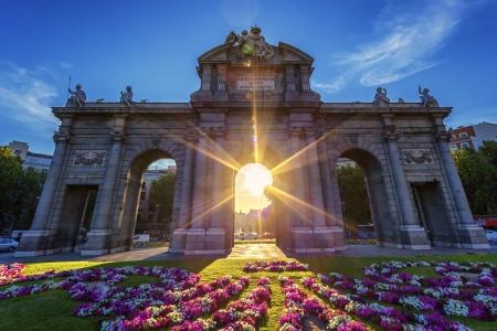 sulight: Puerta de Alcala at sunset, Madrid, Spain Stock Photo