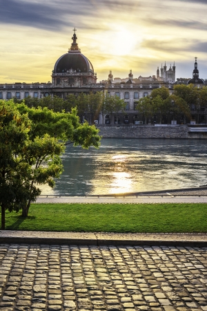Famous Lyon city at sunset with Rhone river