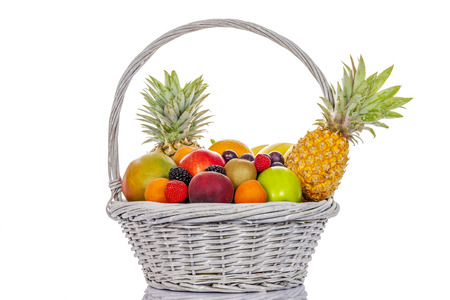 citrous: still life of multi-coloured fruits in big basket, on white background, isolated