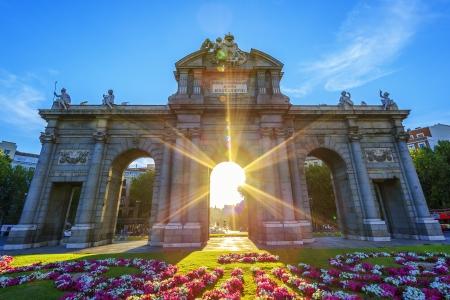 sulight: Famous Puerta de Alcala at sunset, Madrid, Spain Editorial