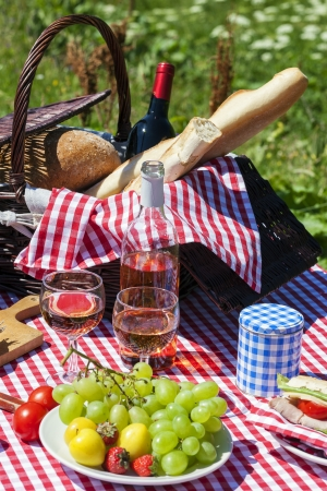 Picnic table with wine photo