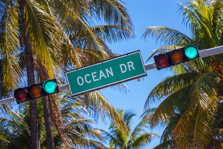 street sign of famous street Ocean Drive in Miami South with traffic light  photo