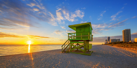 miami south beach: Famous Miami South Beach sunrise with lifeguard tower