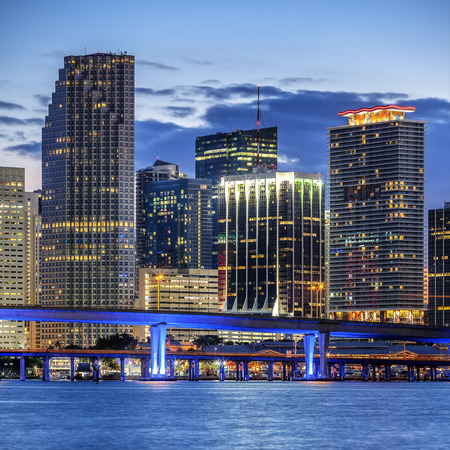 south beach: CIty of Miami Florida, illuminated business and residential buildings and bridge on Biscayne Bay