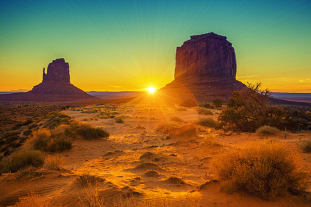desert storm: Sunset at the sisters in Monument Valley, USA