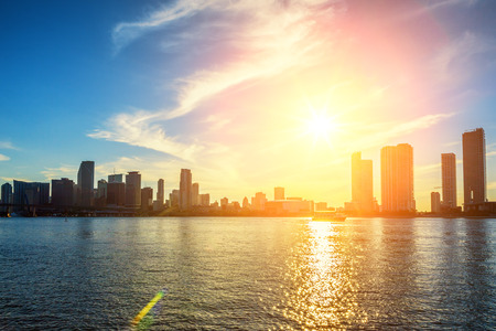 city of miami: Miami Florida, sunset  with colorful illuminated business and residential buildings  Stock Photo