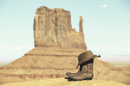 navajo: Boots and hat in front of Monument Valley with special photographic processing