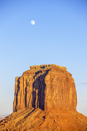 monument valley view: Vertical view of Monument Valley with moon