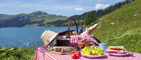 Picnic in french alps with lake, panoramic view photo