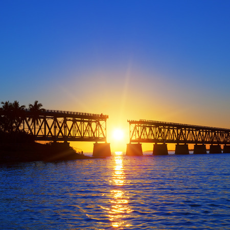 Colorful sunset with famous broken bridge, Keay West