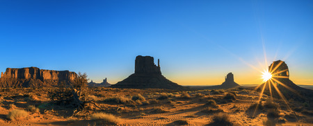 national monuments: Panoramic view of Monument Valley Tribal Park At Sunrise, Arizona  Stock Photo