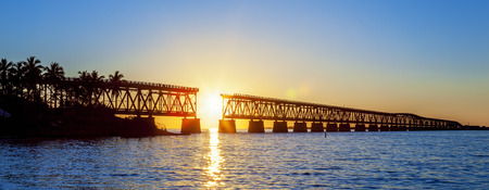 florida landscape: Colorful sunset with famous broken bridge, Key West, panoramic view