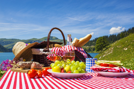 picnic cloth: Picnic in french alpine mountains with lake on background