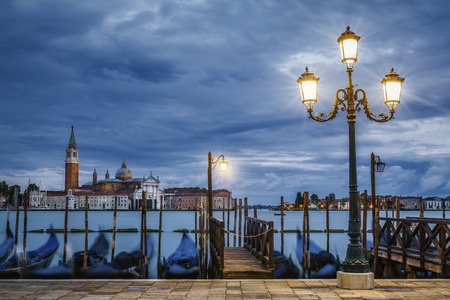 giorgio: Gondolas floating in the Grand Canal after sunset Stock Photo