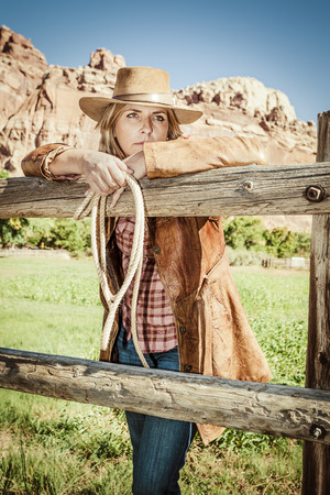 Portrait of beautiful cowgirl with hat  photo