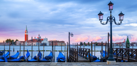 Gondolas floating in the Grand Canal, panoramic view photo