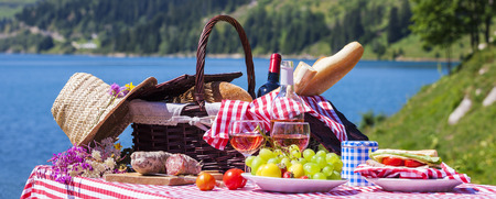 Picnic in french alpine mountains with lake on background, panoramic view photo